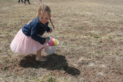 Little girl hunting eggs