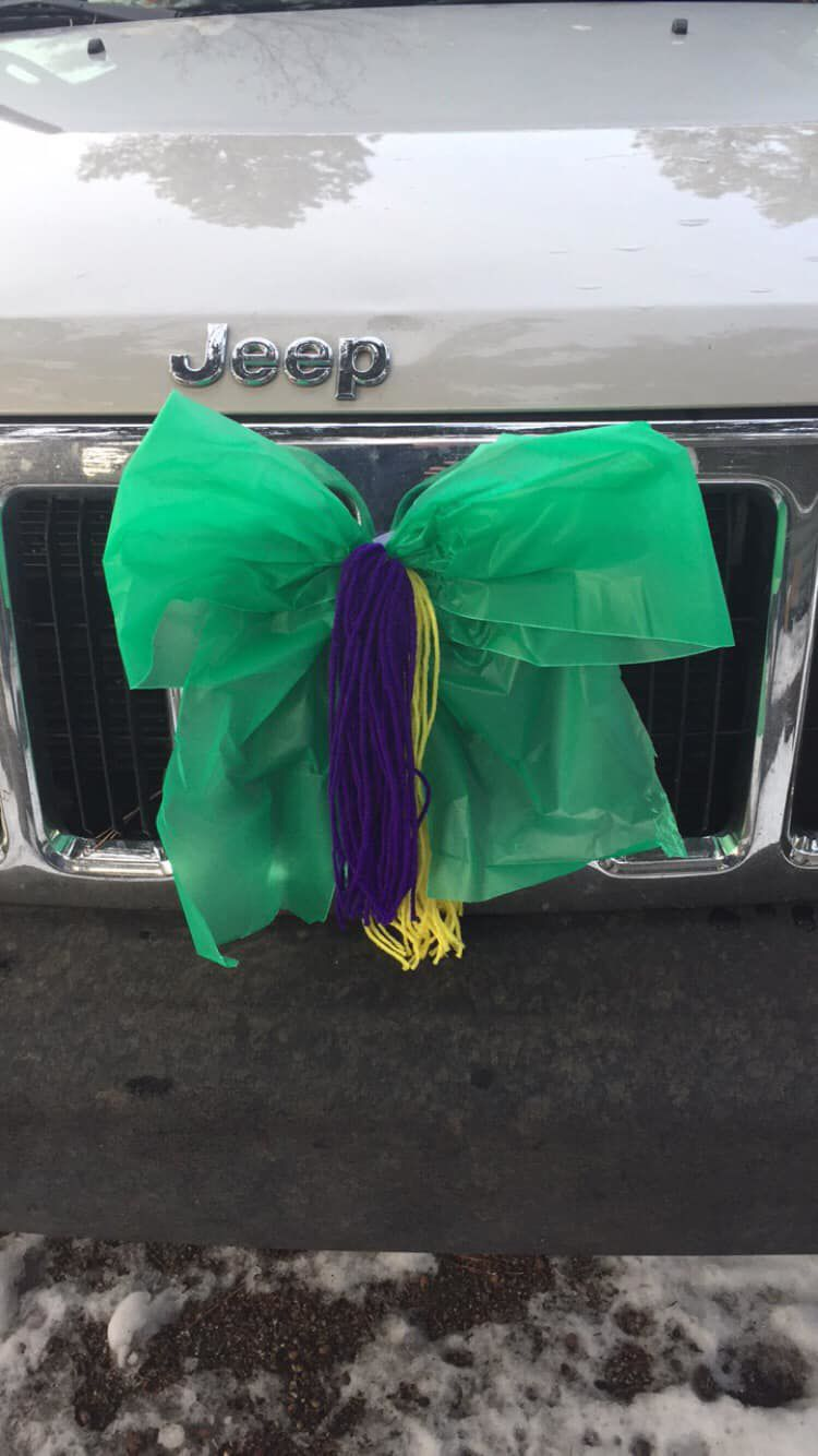 Coming home to open arms - gold, purple and green ribbons