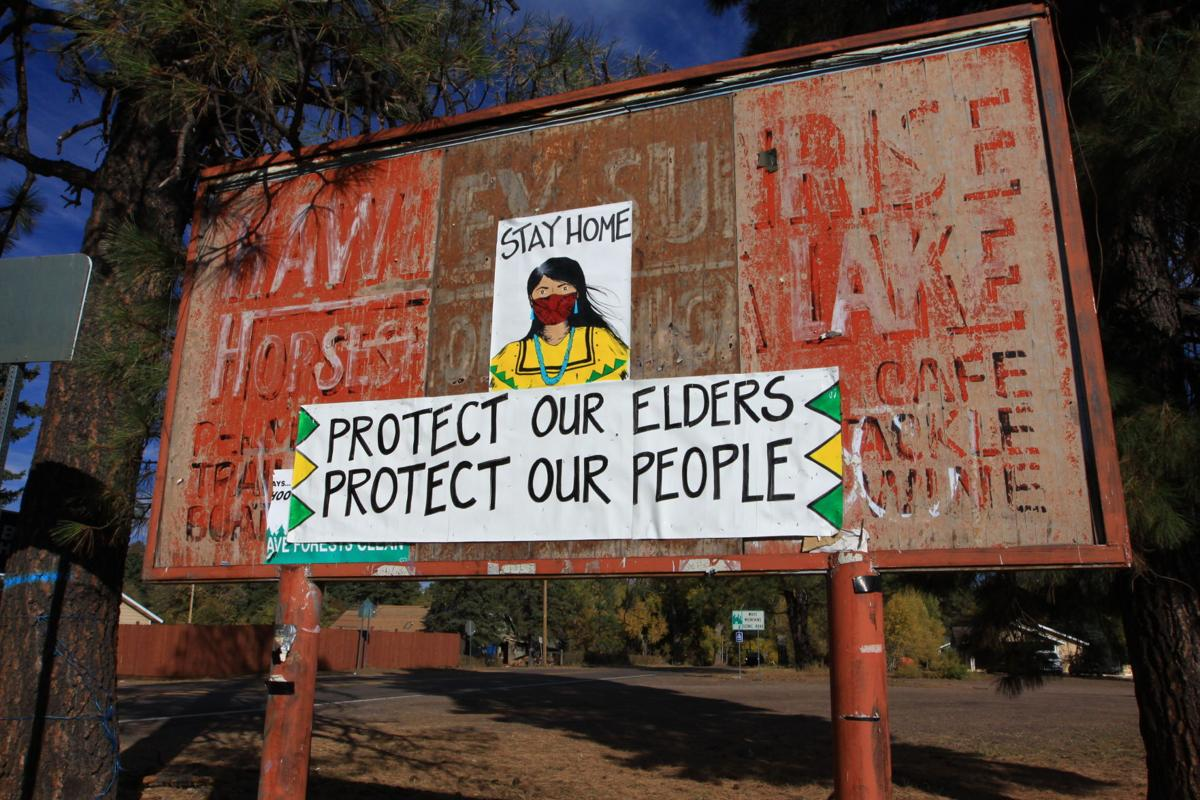 WMAT sign.JPG - Protect our elders Protect our people sign