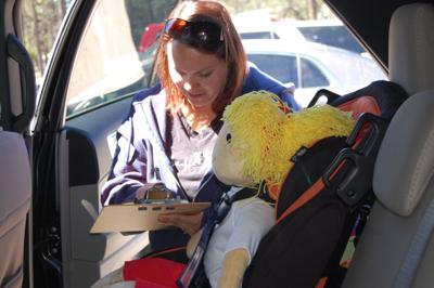 Kassie Mason Of The Joseph City Fire Department Determines How A Child Safety Seat Was Installed In Back Improperly During May 2 Certification