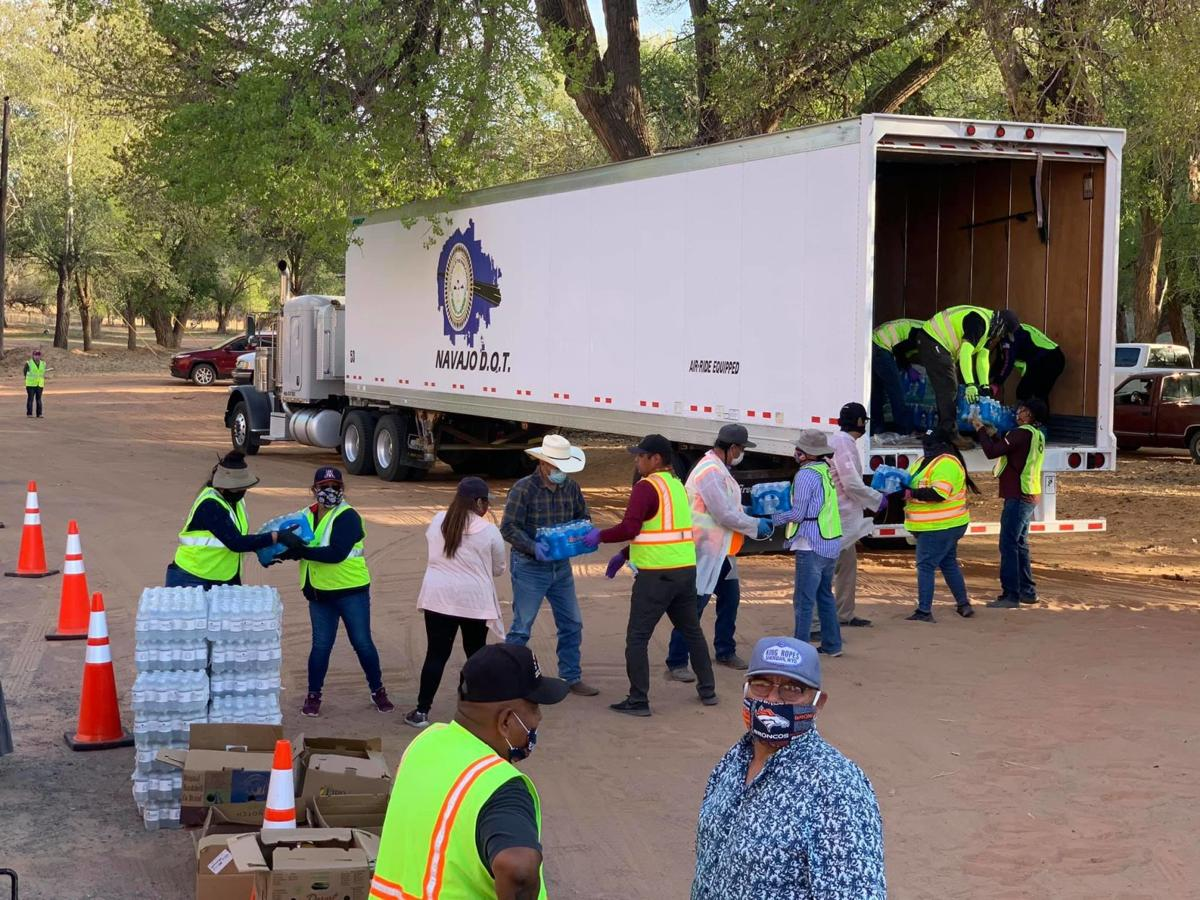 Navajo Nation still expecting relief from CARES Act -people unloading supplies