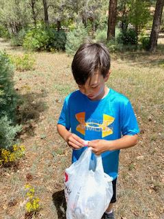 Student helping - picking up trash