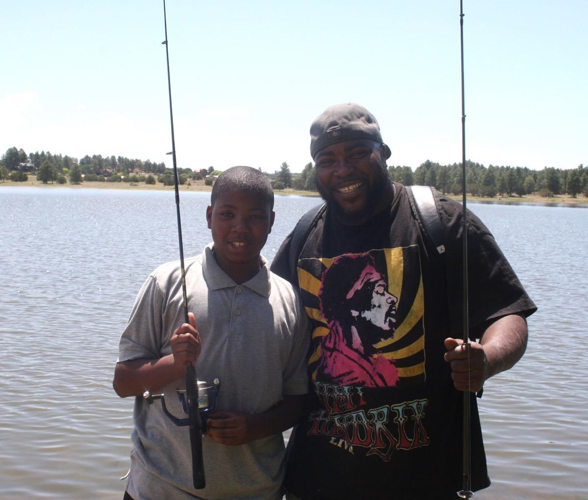 Annual Fishing Derby - Father and son