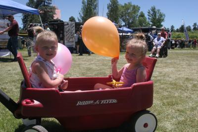 Twins in red wagon at Show Low Days 2018