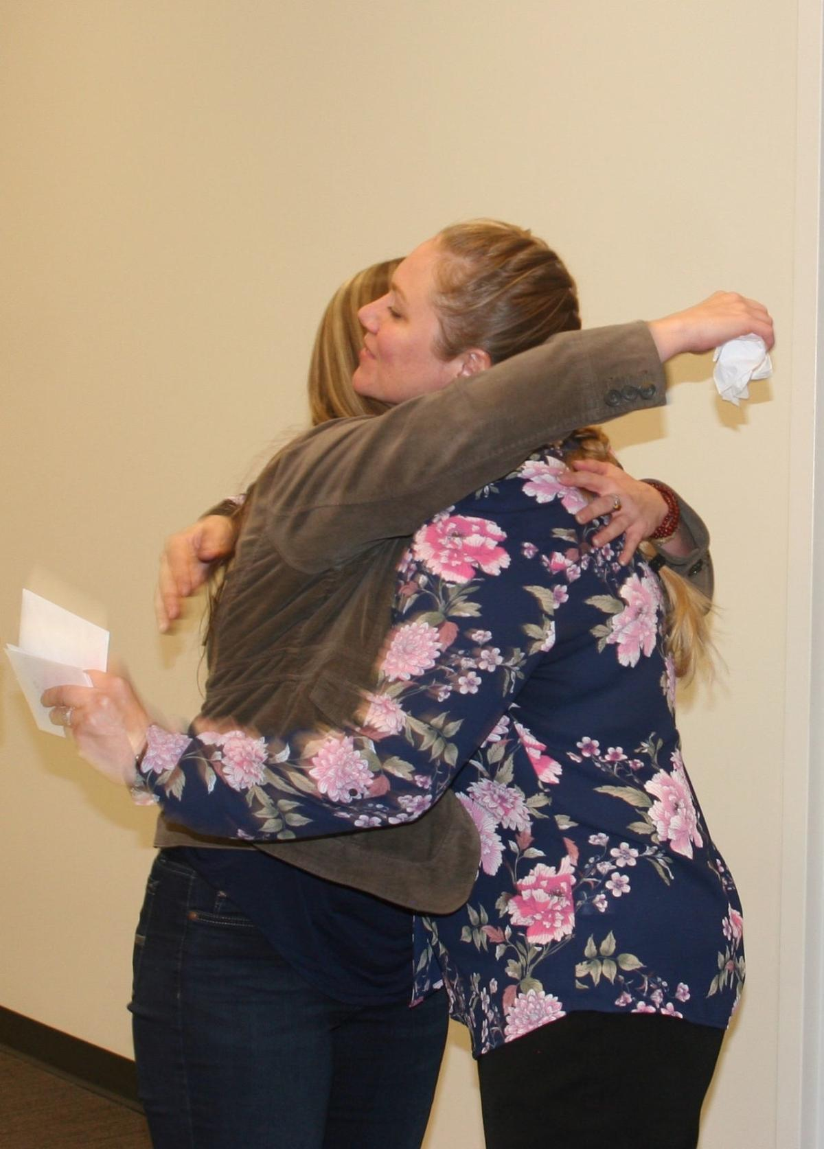Peer Support Specialists  - Allison hugs Brianna