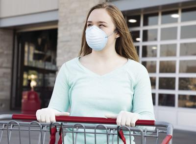 Arizona's gains against COVID-19 may have stalled - woman in mask