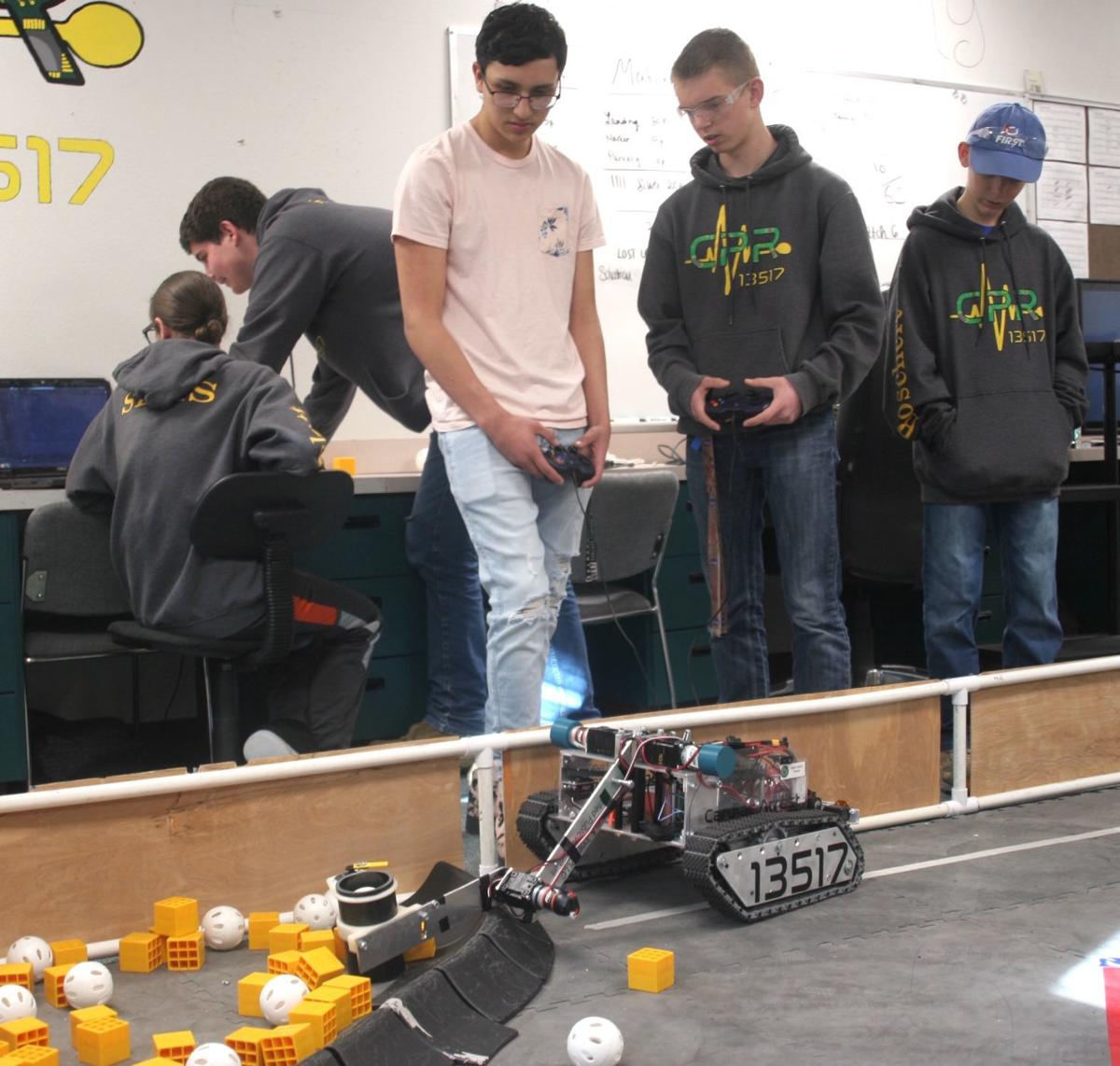 Robots invade - two students control the robot