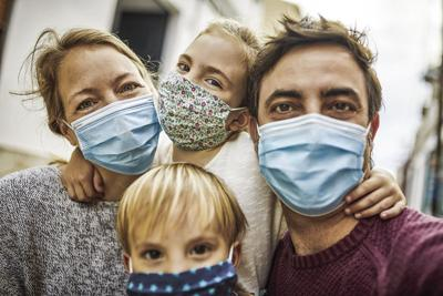Family wearing a mask