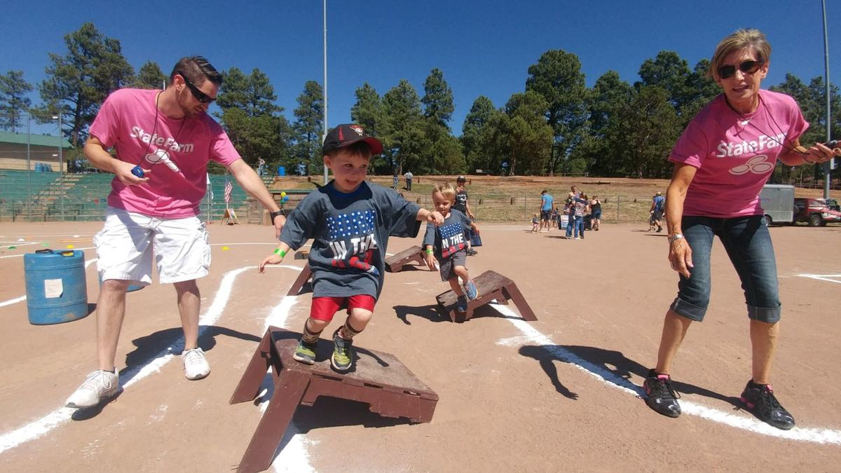 Itty Bitty Olympics - Jill Tinkle and son, Trevor coach the competitor