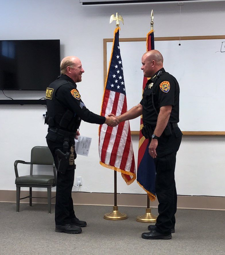 Bevington named new Eagar police chief - Shaking hands after swearing in