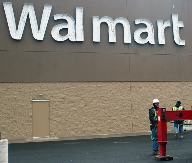 Putting Up The Walmart Logo On Facade Of New Building In Taylor Happens Stages And Sometimes Even Requires Adjustment Bootz Duke Signs From