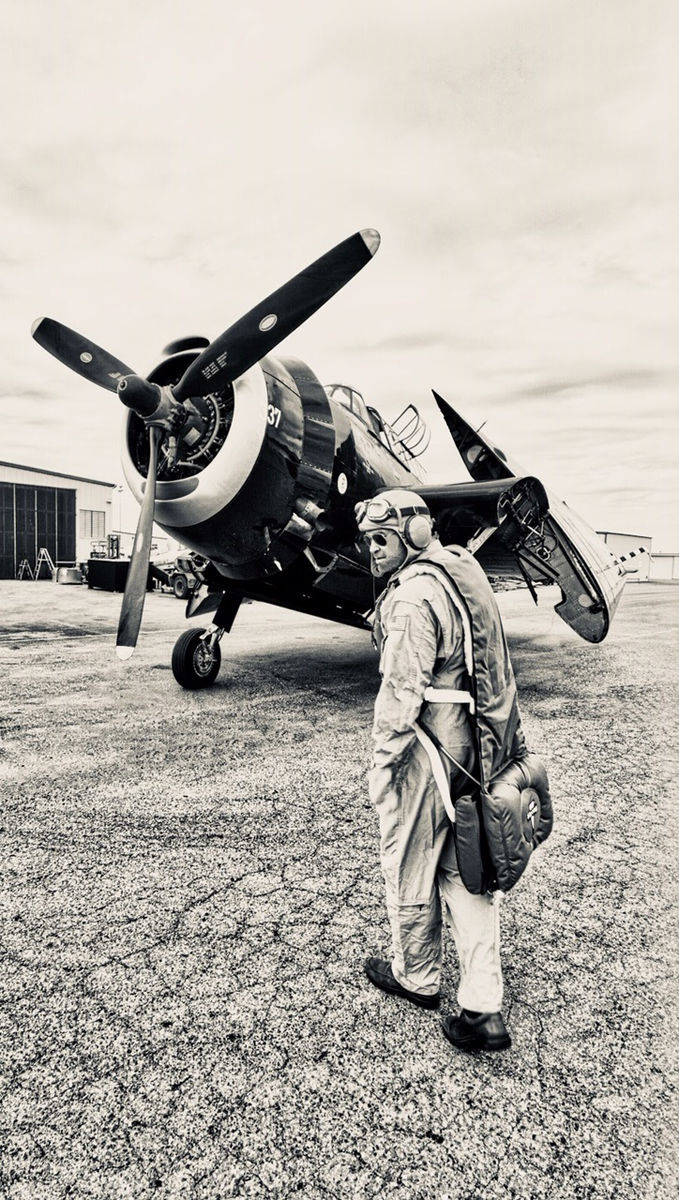 Carlson with parachute on before flight