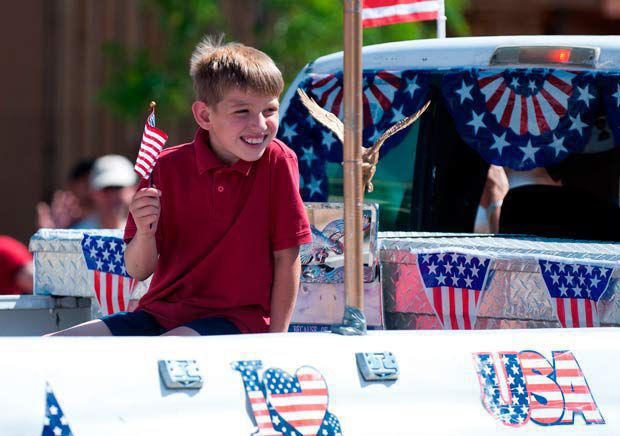Show Low's 4th of July parade, wet zone and Freedomfest
