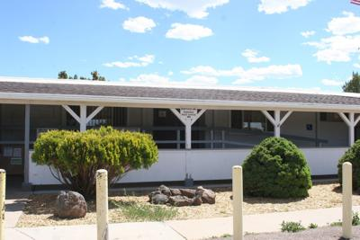 White Mountain Lake meeting room and post office building
