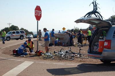 Driver hits cyclist, knocks three more down