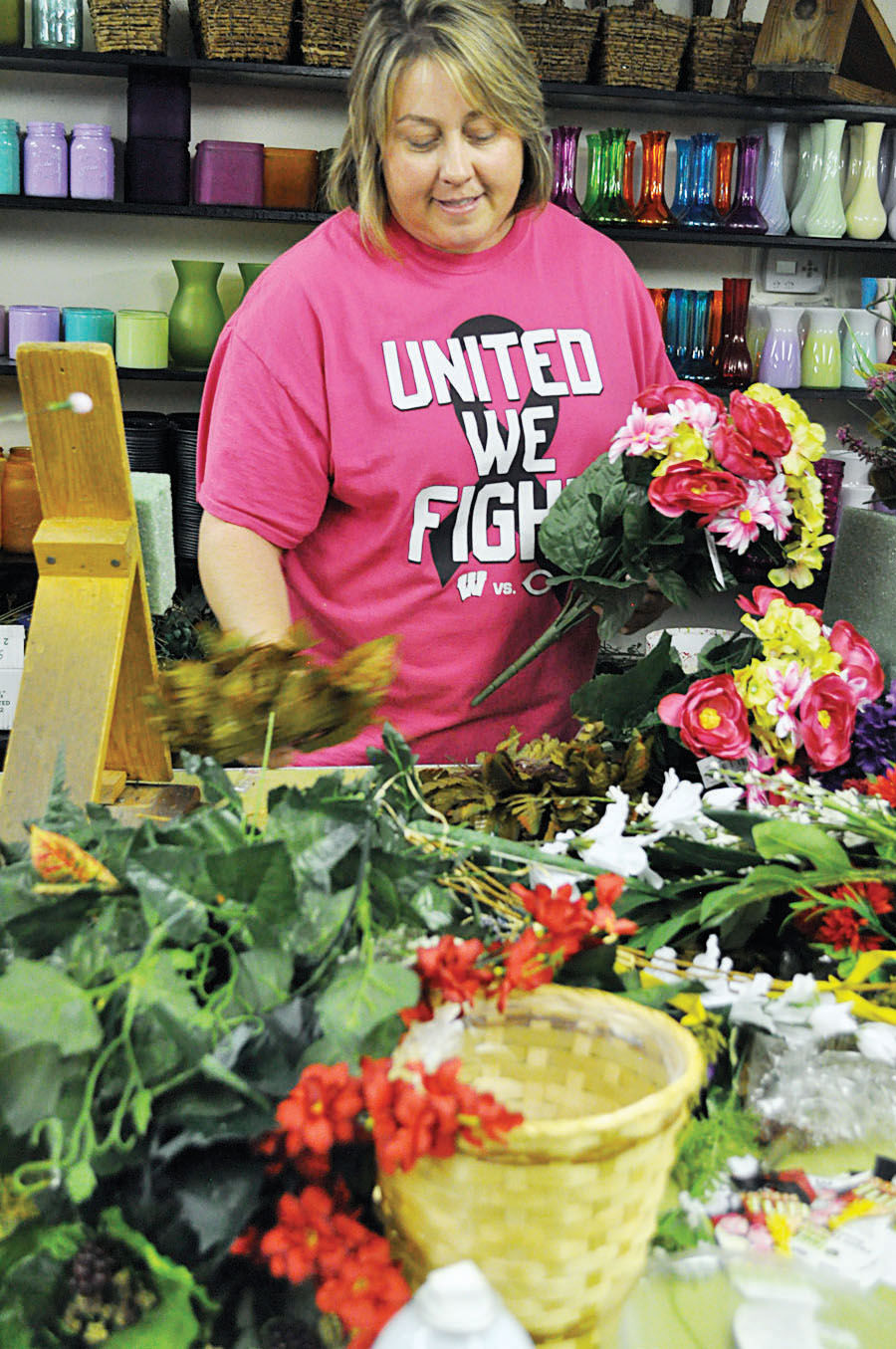 Florists help with monthly senior birthday party news akard florist owner amy haskins works at preparing greenery for arrangements meant for the woodward senior center birthday party held every month on the izmirmasajfo