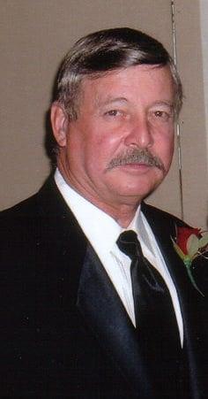 ROBERT (BOB) L. DRAKE