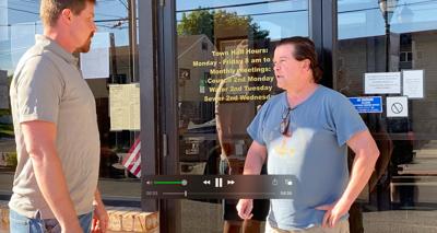 DeLauder blocking town hall door