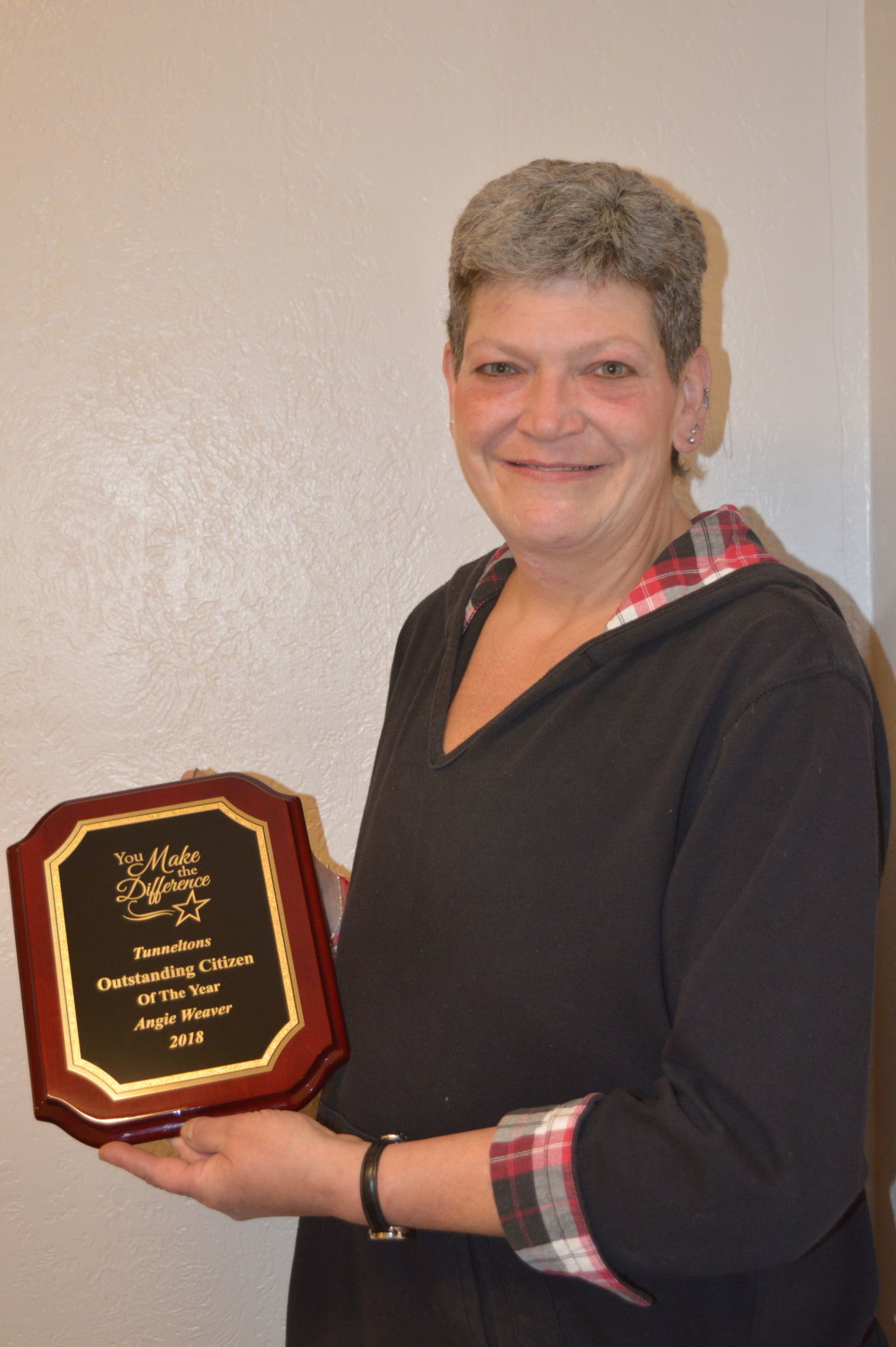 Angie Weaver with plaque