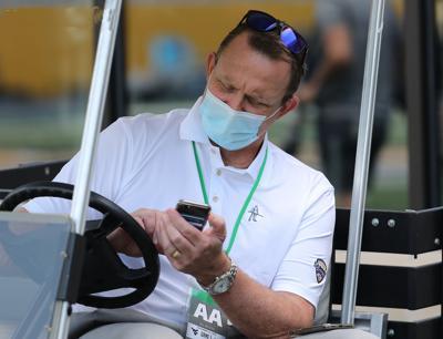 0914 Shane Lyons checks phone copy.jpg (copy)