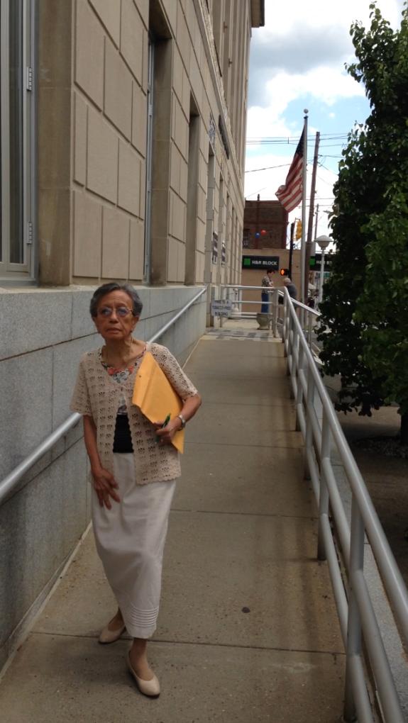 Leaving court after her sentencing