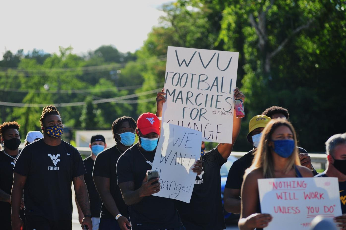 WVU football marches for unity and justice
