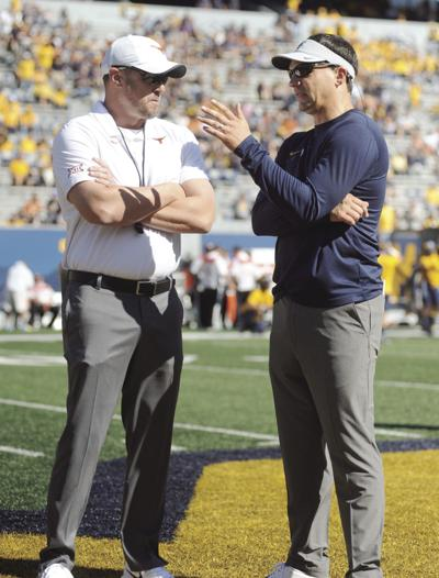 1007 Texas Tom Herman chats with Neal Brown copy.jpg