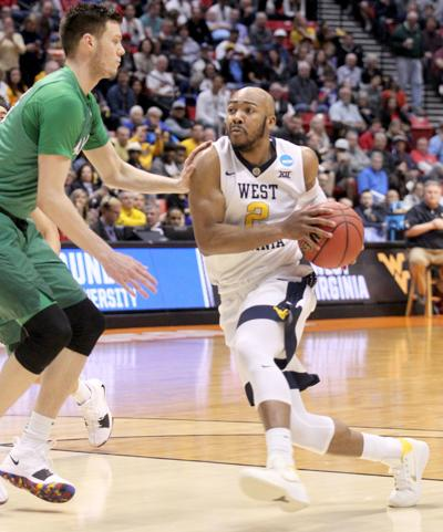c11138e61 WVU basketball 031817 Jevon Carter drives the lane.jpg