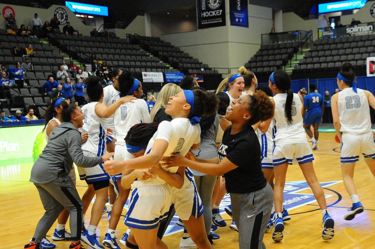 Lady Pioneer celebration on winning the 2020 MEC title for a third straight year.JPG