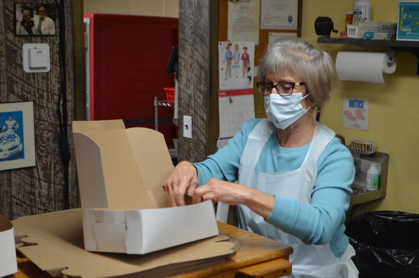 Galambus prepares boxes