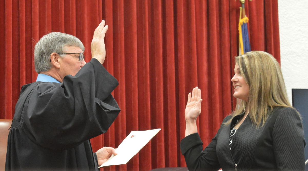 Stone takes oath of office