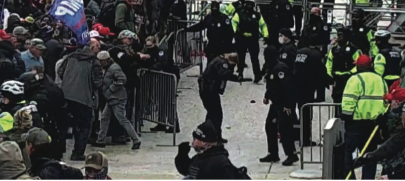 Officers hit with spray