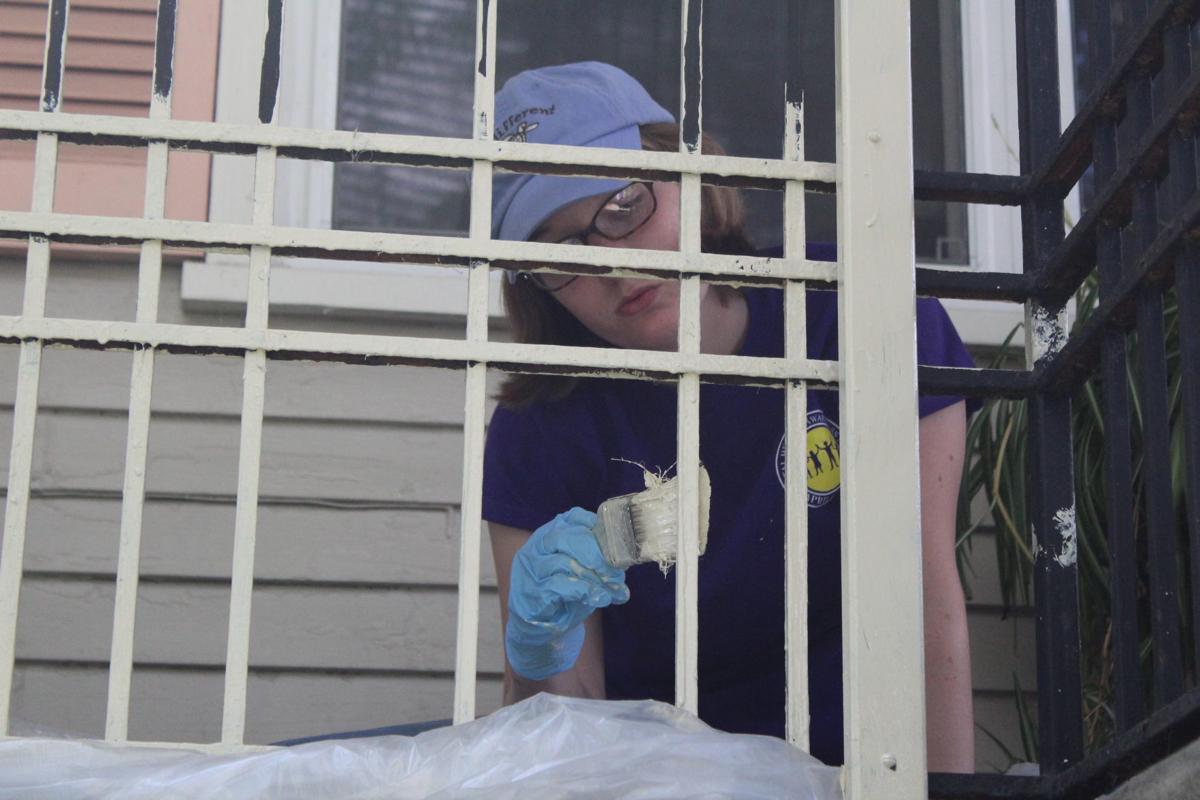 Volunteers paint house