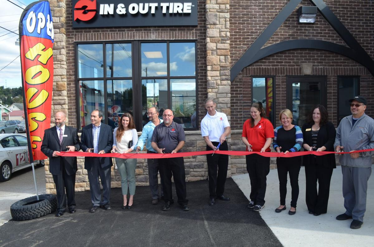 In & Out Tire ribbon cutting