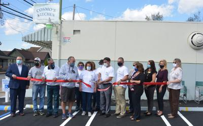 Restauranteurs and Clarksburg, West Virginia, residents cut the ribbon to ceremoniously open Cosmo's Kitchen
