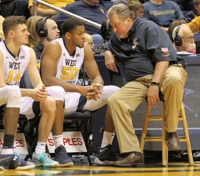 WVU coach Bob Huggins has a heart to heart with Sagaba Konate