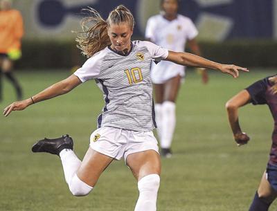 0808 WVU women_s soccer Jordan Brewster kicks copy.jpg