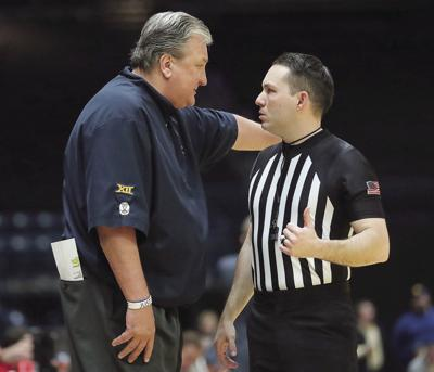 Huggins talks to official