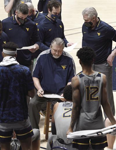 0227 Bob Huggins huddle Kansas State copy.jpg