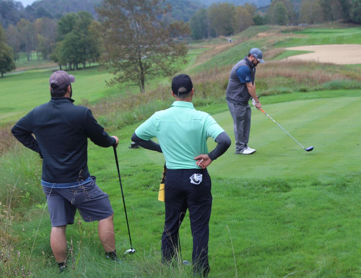 6e34352e2e9e8 Golfers brave the rain Monday for 23rd annual Dominion Charity Golf ...