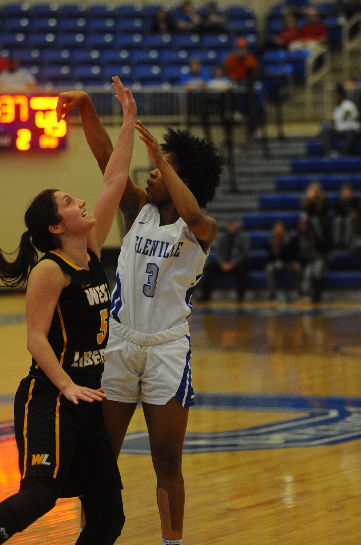 GAS Ty Armstrong nails a deep 3 with WLU Audrey Tingle in her face