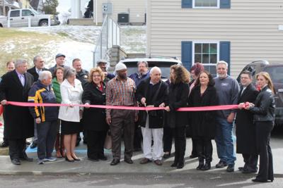 d27387a8 Officials and dignitaries attend the ribbon cutting ceremony for a new  affordable housing development on Wednesday.
