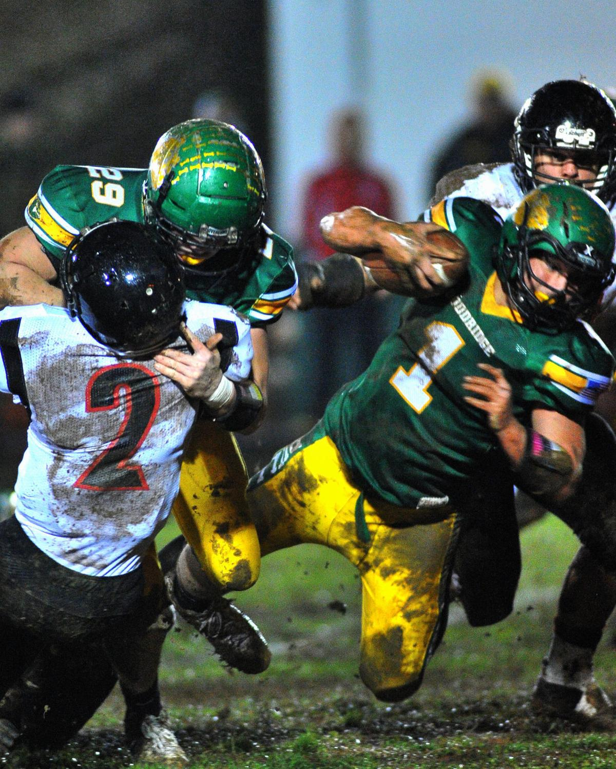 Hunter America flies thru the air for a first down early in the game.JPG