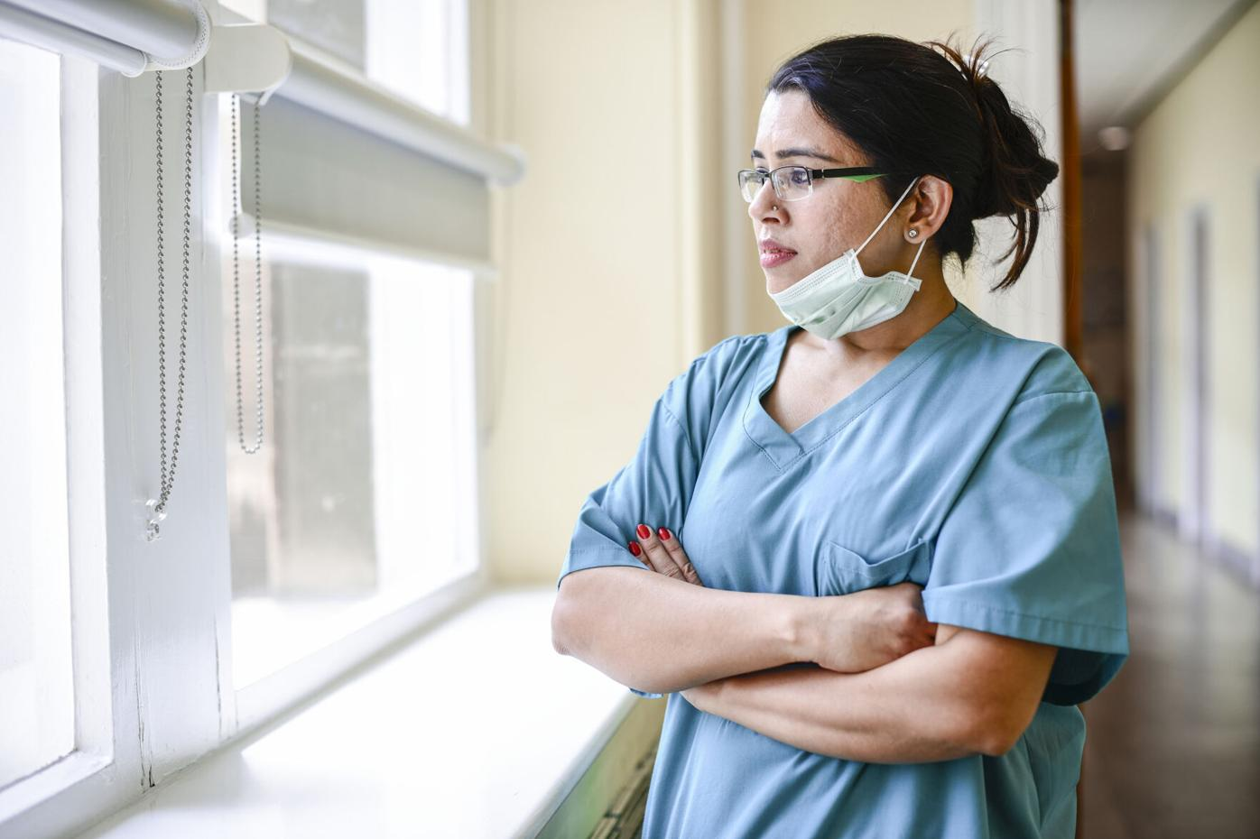 Female nurse staring out the window