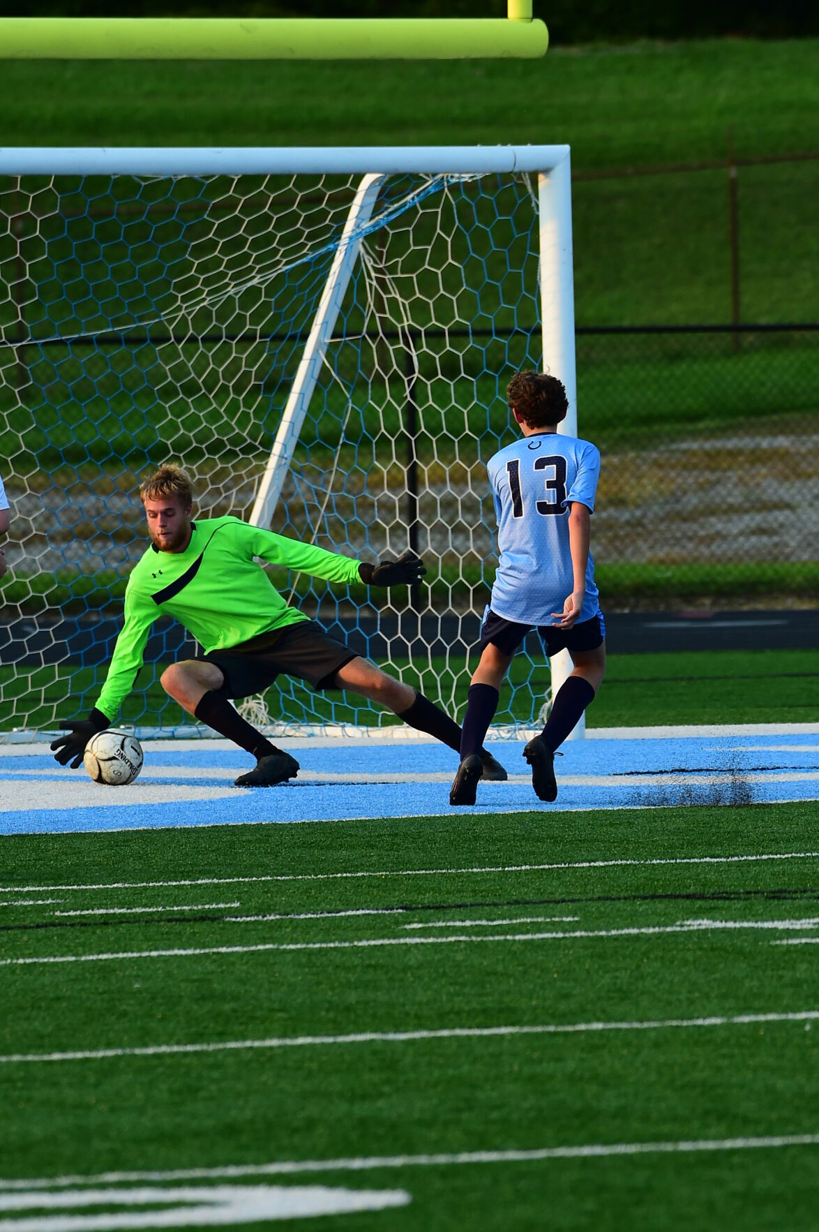 PB 13 Connely Sparks is stuffed point blank by ND goalie Wade Britton.JPG