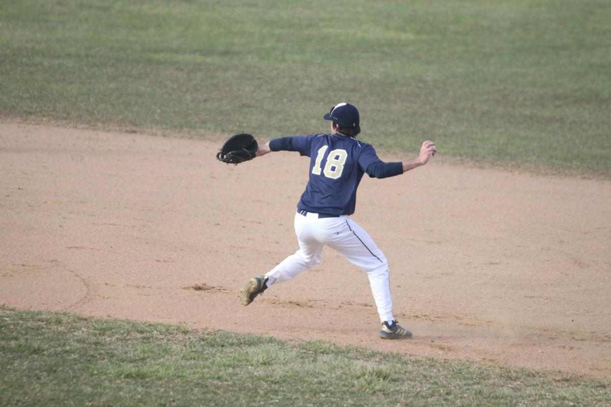 Paxton Nichols throws to second after fielding a grounder
