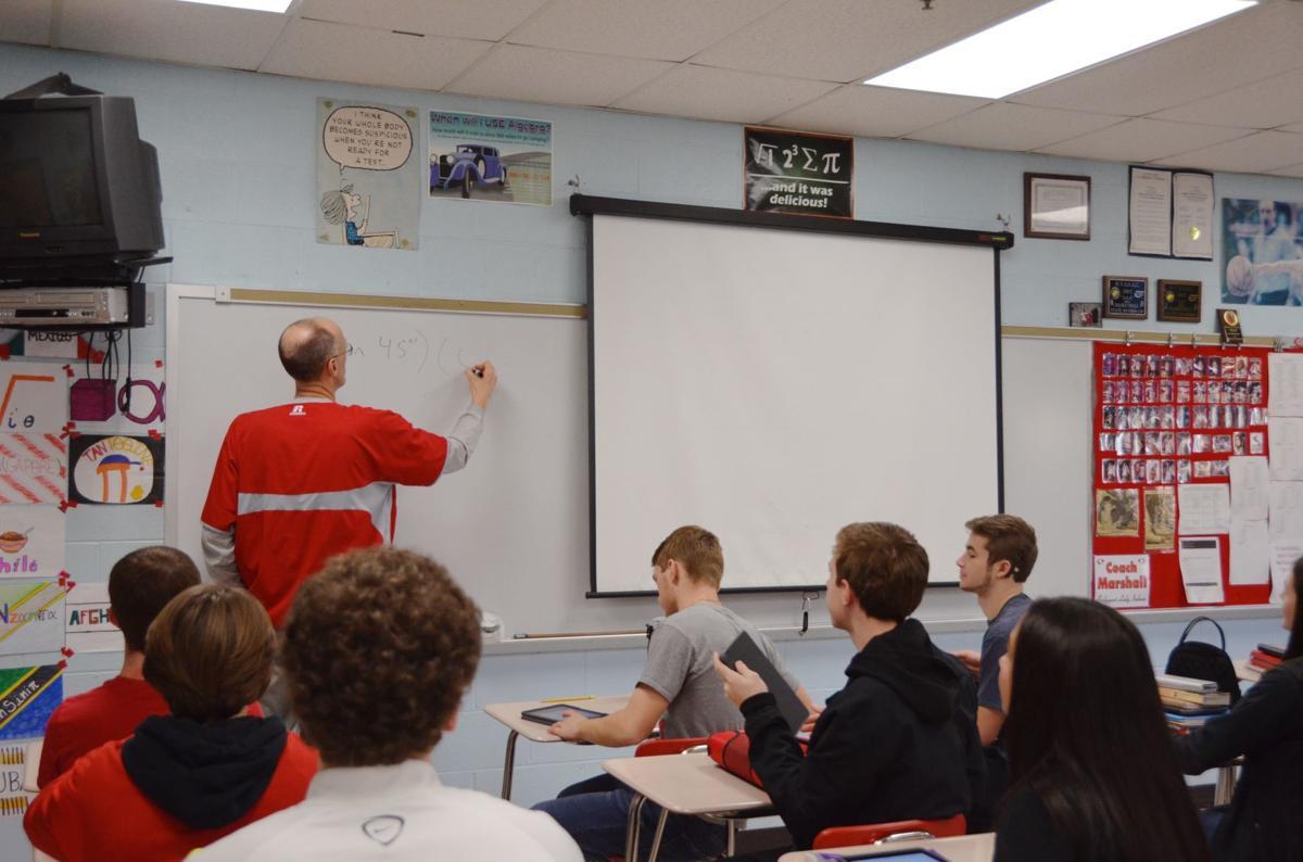 Teaching his math class