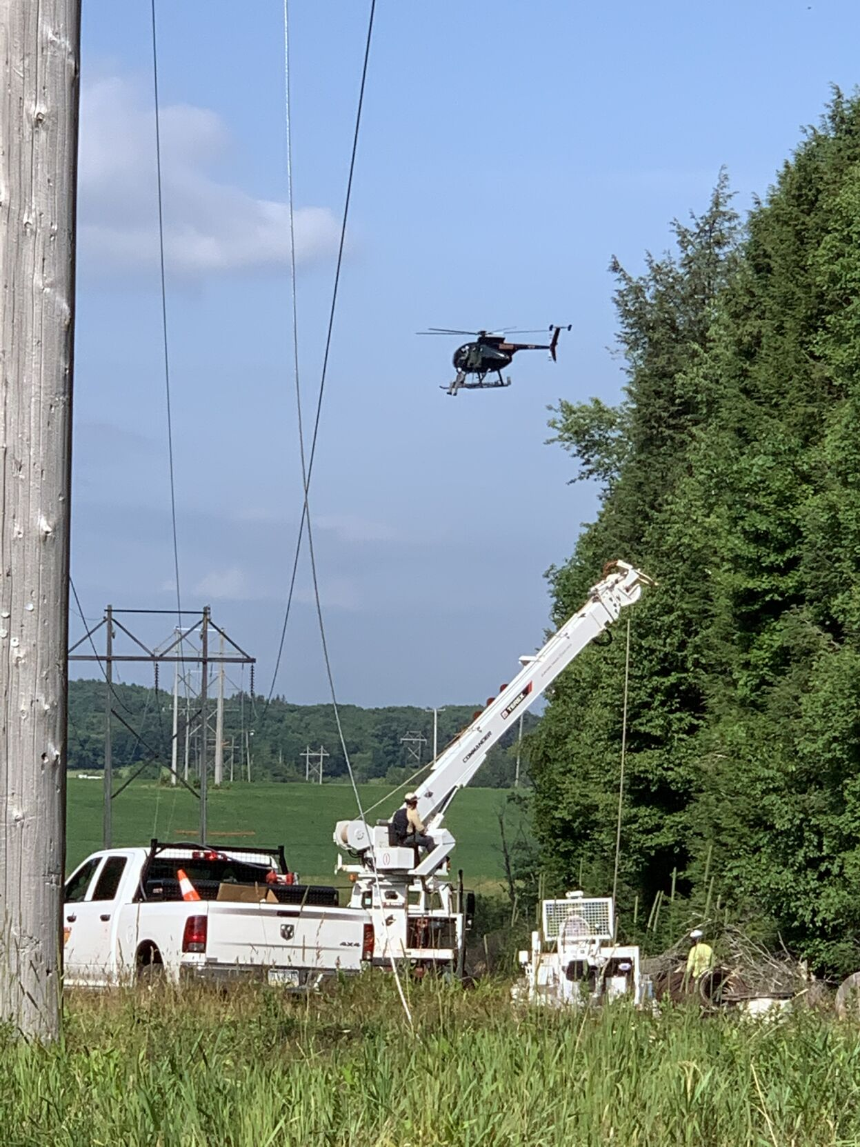 Helicopter at power lines