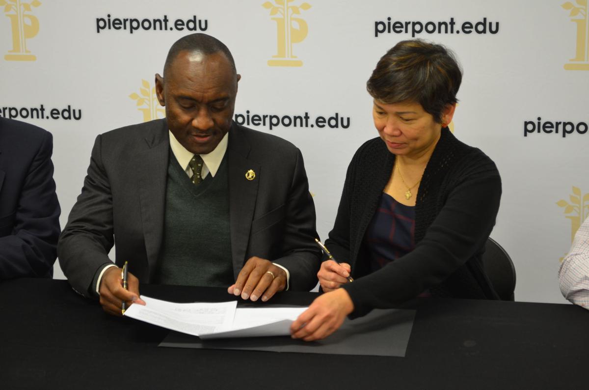 Moore and Verzosa sign memorandum