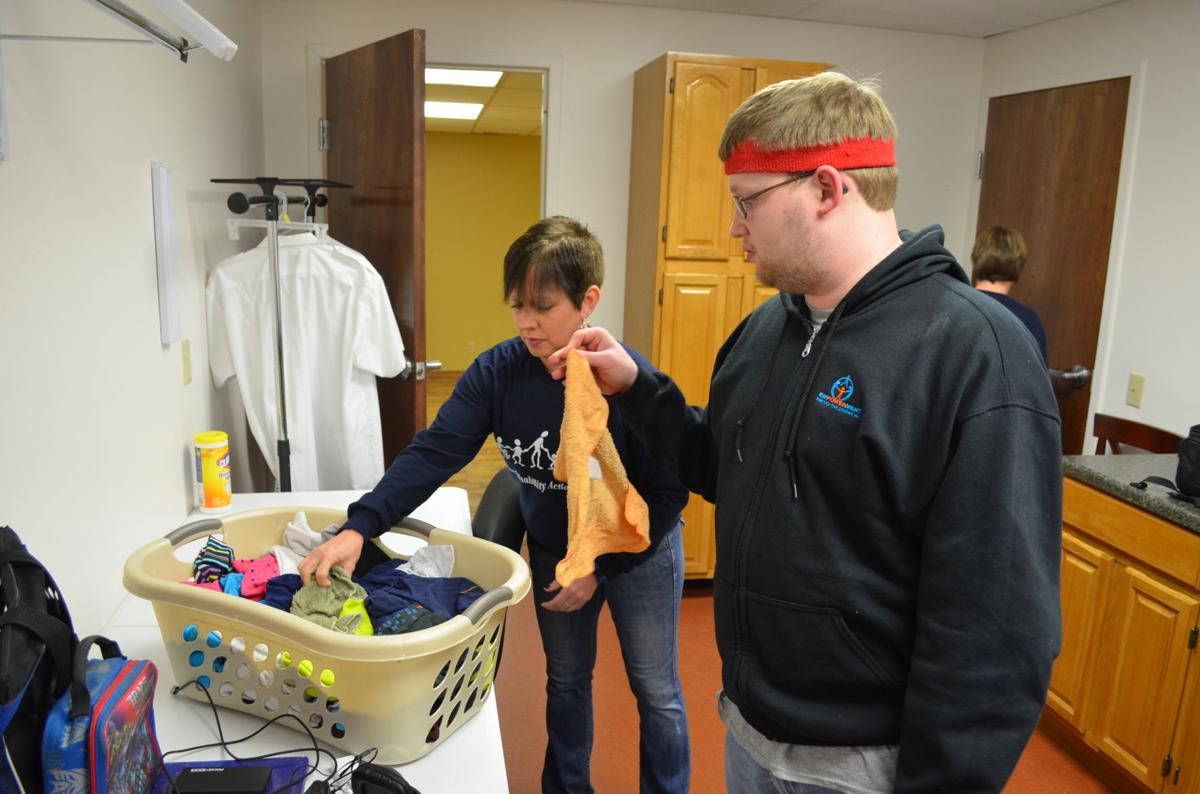 941307a91033a5 Job coach Chrissy Heldreth helps laundry attendant Jordan McNemar sort a  load of rags and socks.